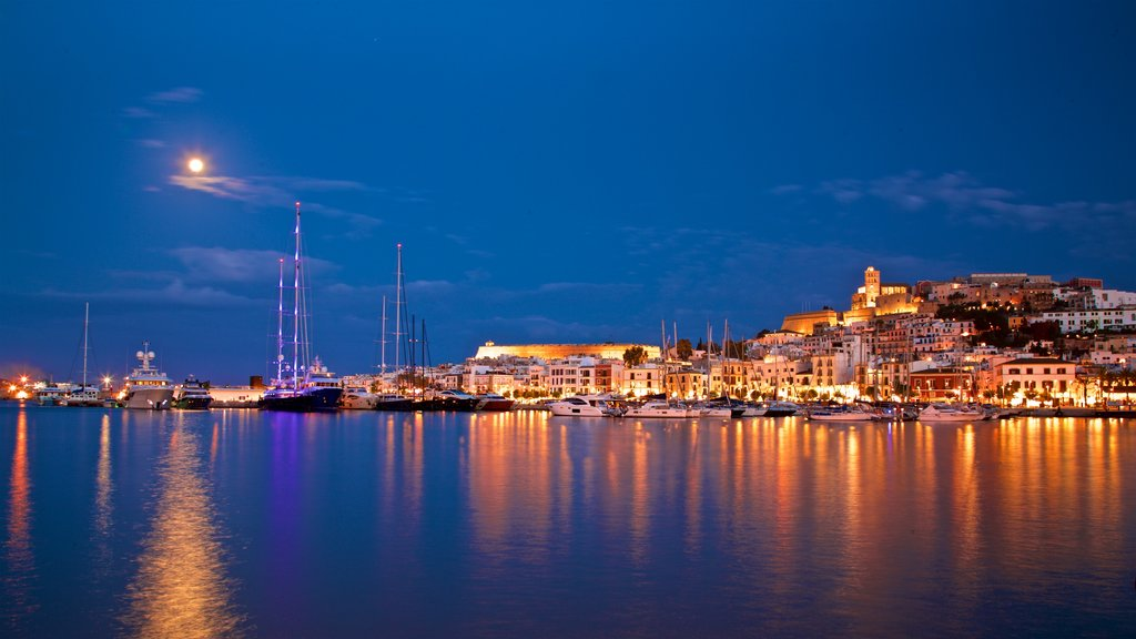 Ibiza City Centre which includes night scenes, a bay or harbor and a coastal town
