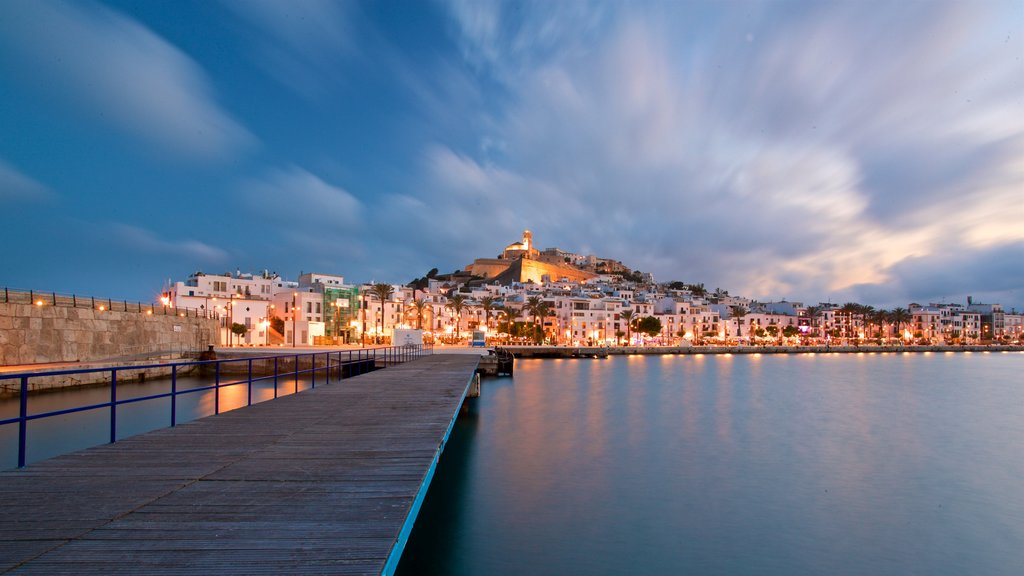 Ibiza Castle showing a bay or harbor, a sunset and a city