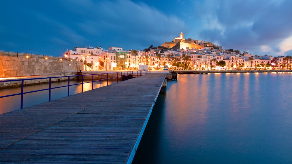 Ibiza Castle which includes a bay or harbor, a city and night scenes