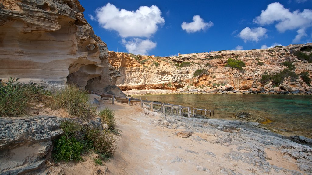Cala en Baster featuring general coastal views and rugged coastline
