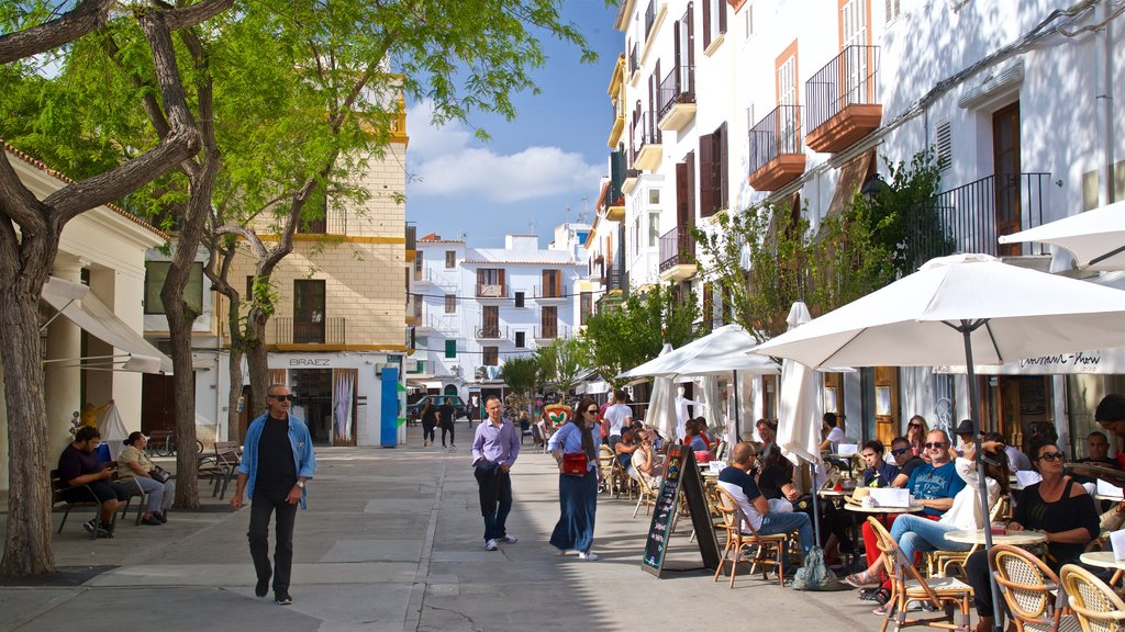 Sa Penya showing street scenes and outdoor eating as well as a small group of people