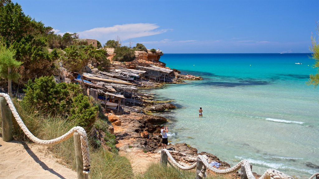 Cala Saona which includes rocky coastline and general coastal views