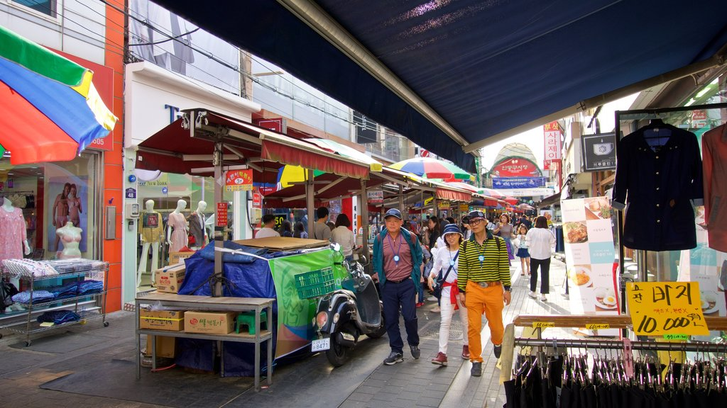 Andong featuring street scenes and markets as well as a small group of people