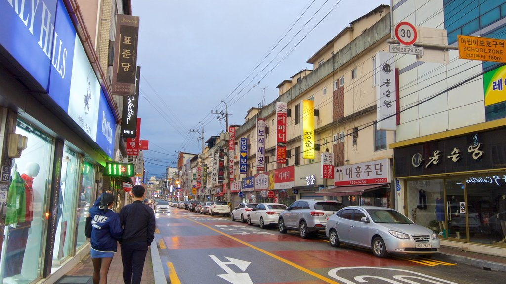 Andong which includes street scenes as well as a couple