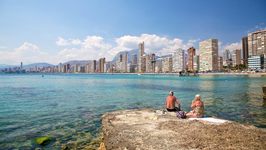 Levante Beach showing general coastal views and a coastal town as well as a couple