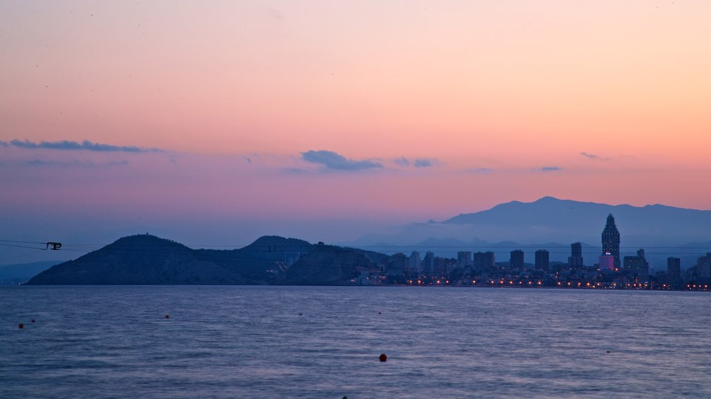 Benidorm which includes a sunset and general coastal views