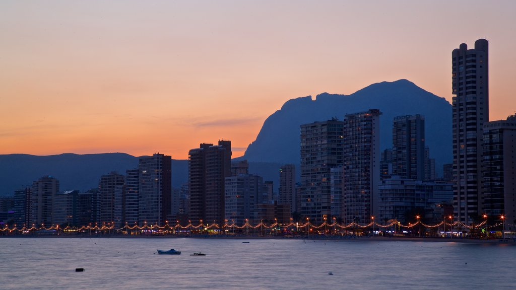 Benidorm which includes general coastal views, a coastal town and a sunset