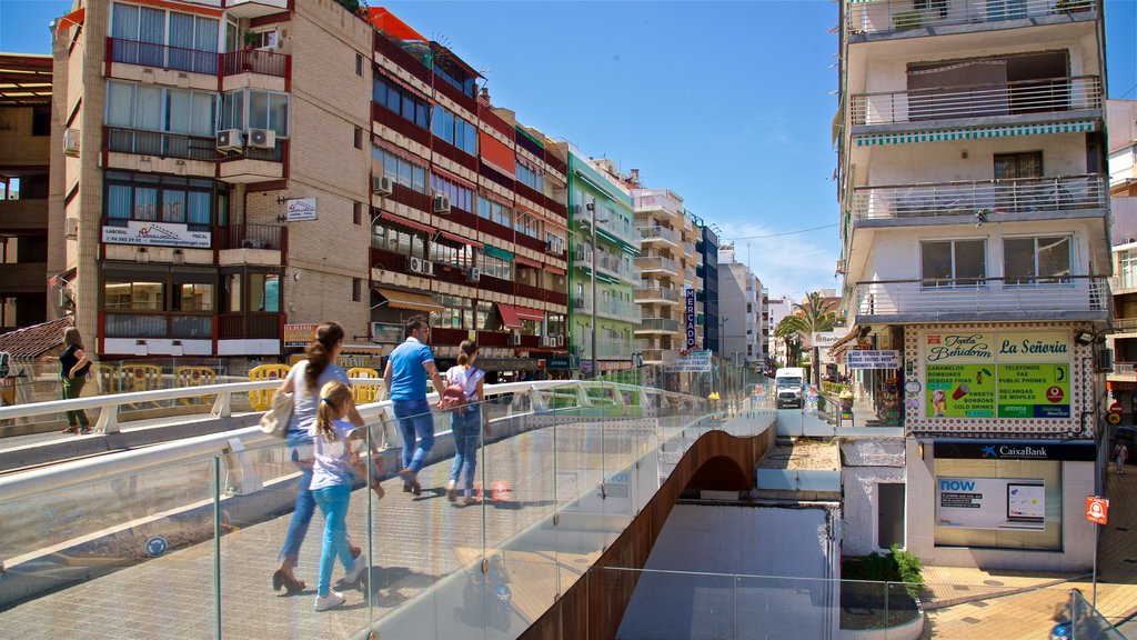 Benidorm Centro featuring street scenes and a city as well as a family