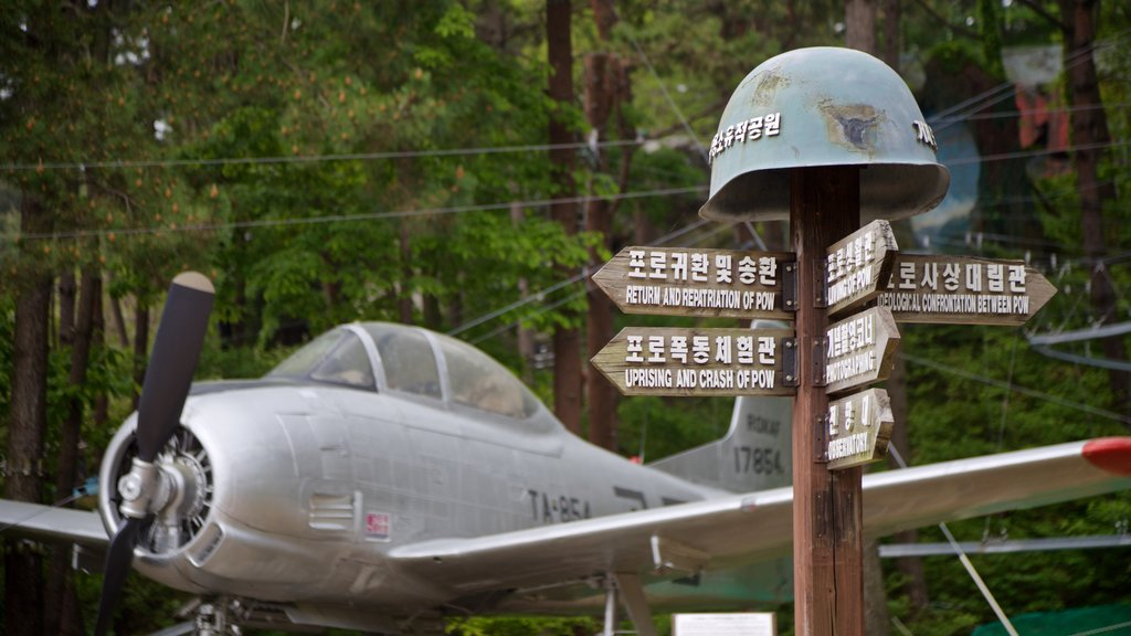 Geoje POW Camp featuring signage, military items and aircraft