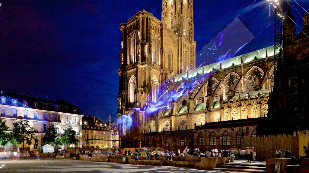 Our Lady of Strasbourg Cathedral which includes night scenes, a church or cathedral and heritage architecture