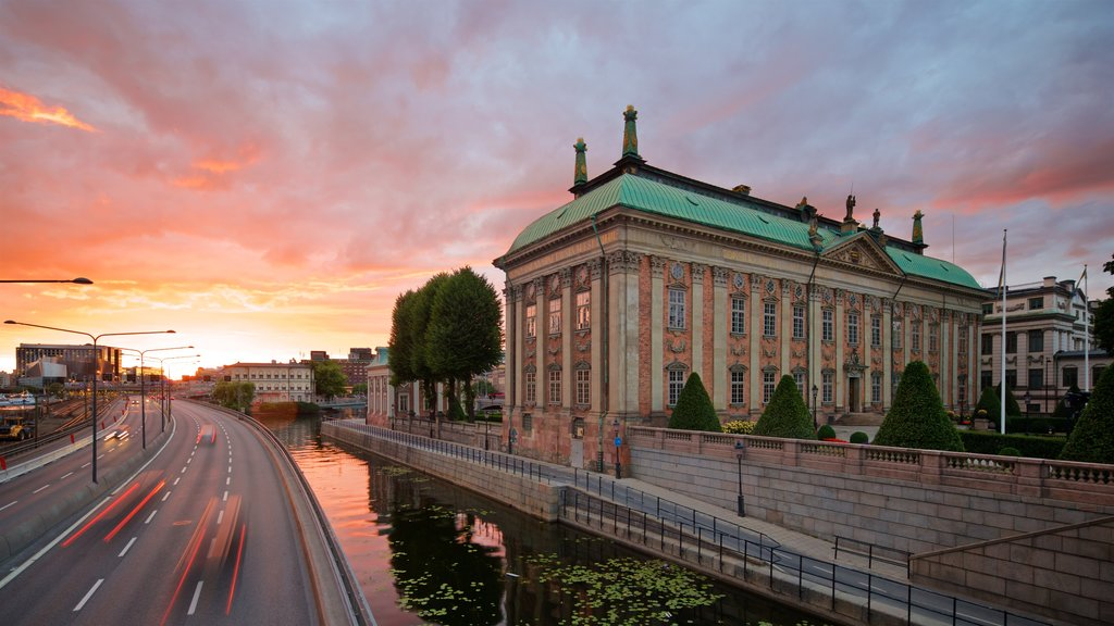Riddarholmen showing a sunset, heritage architecture and a city