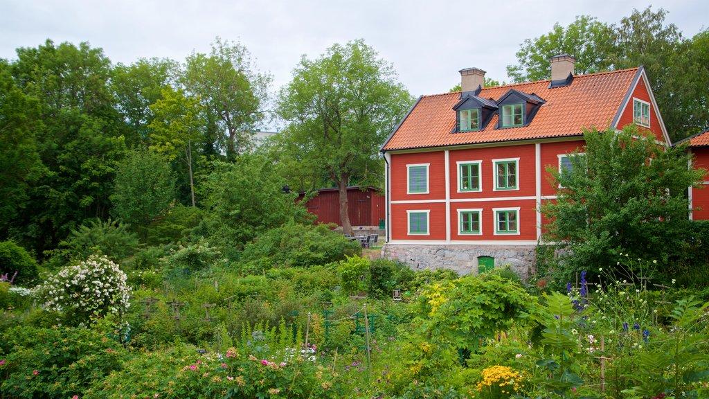 Langholmen ofreciendo un jardín, una casa y flores silvestres