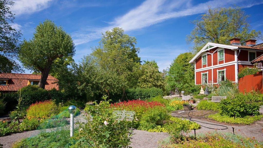 Skansen mostrando un parque, flores silvestres y una casa