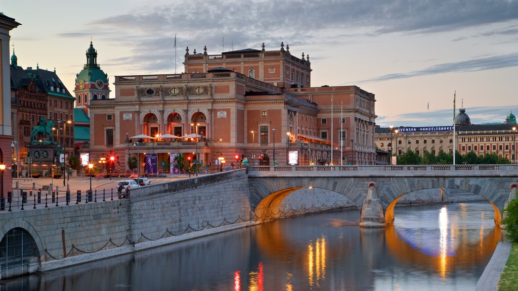 Royal Swedish Opera which includes a sunset, a river or creek and heritage architecture