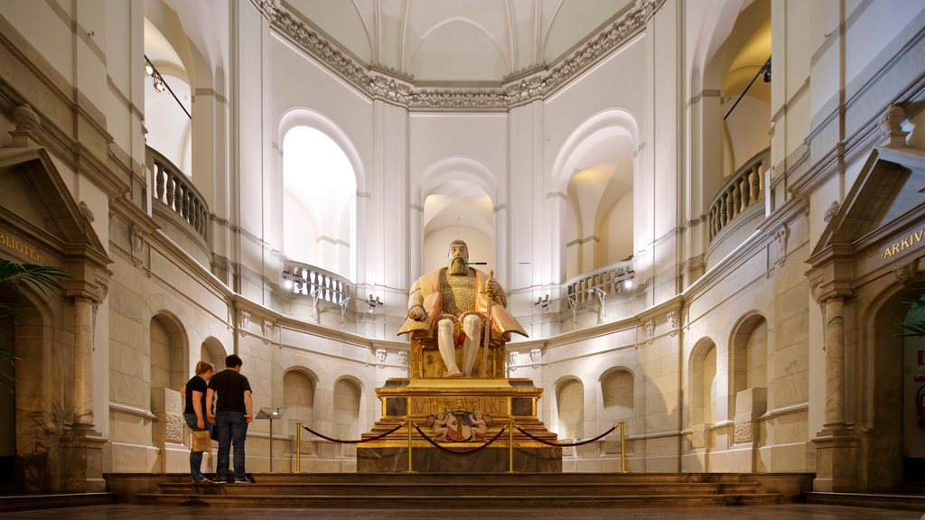 Nordic Museum showing interior views, a statue or sculpture and heritage elements