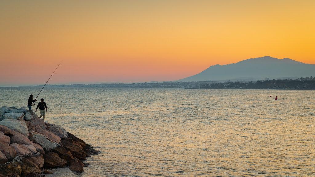 Marbella showing general coastal views, a sunset and fishing