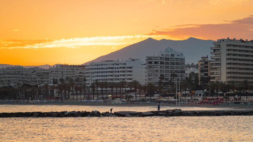 Marbella featuring a coastal town and a sunset