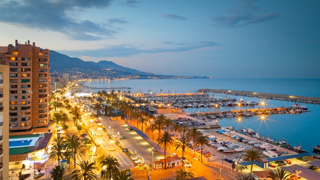 Fuengirola which includes landscape views, night scenes and a coastal town