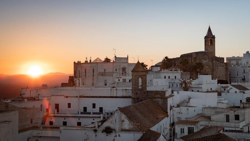 Vejer de la Frontera which includes a city, a sunset and landscape views