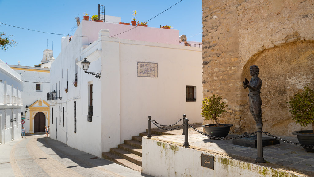 Vejer de la Frontera which includes a statue or sculpture