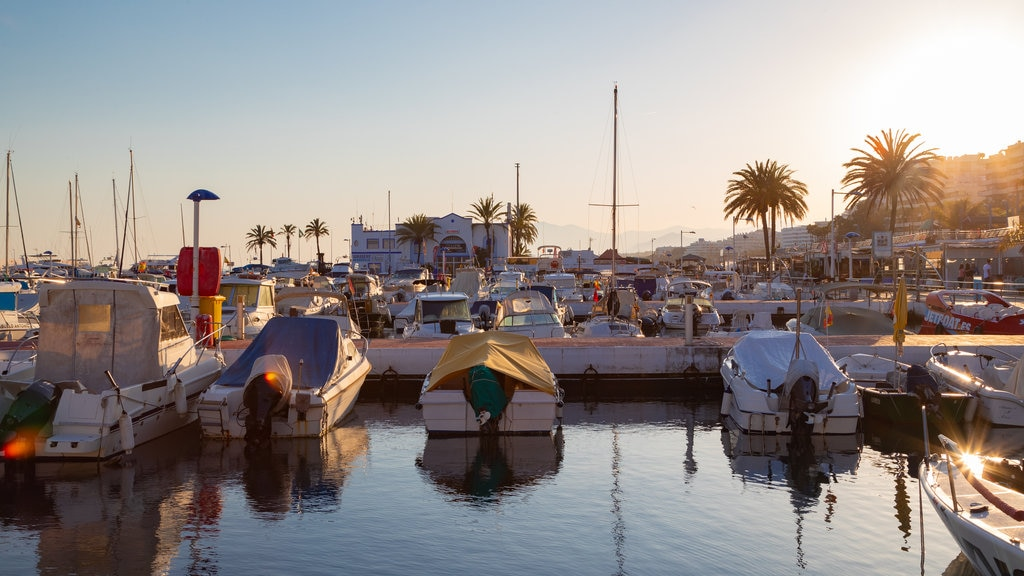 Marbella Marina showing a bay or harbor and a sunset