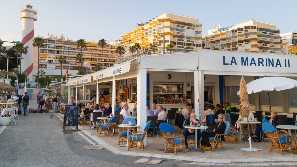 Marbella Marina featuring outdoor eating as well as a small group of people