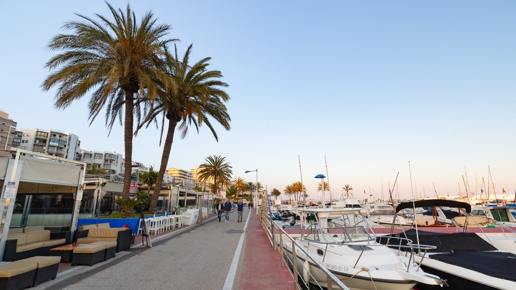 Marbella Marina which includes a bay or harbor and a coastal town