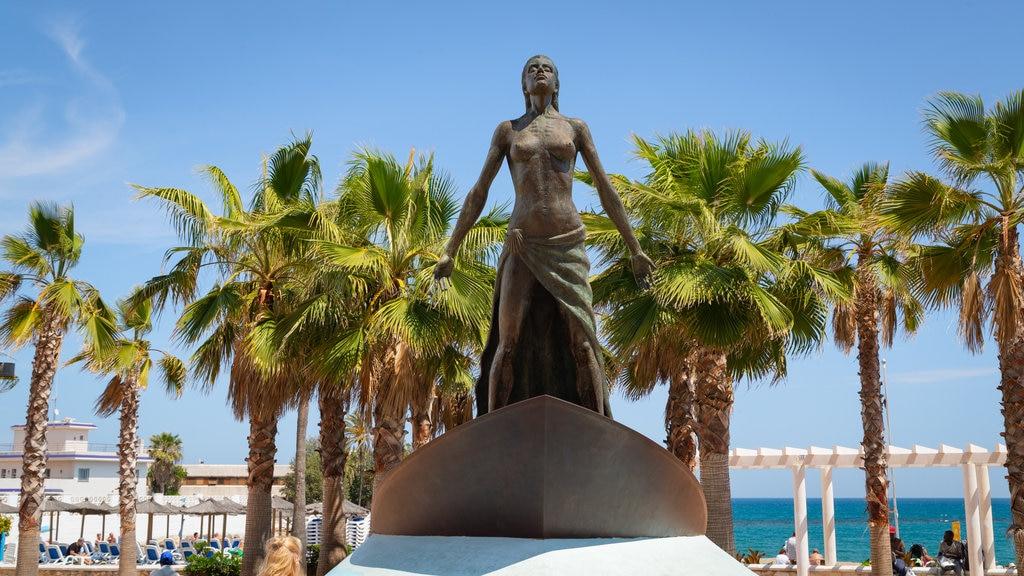 Fuengirola Beach which includes a statue or sculpture