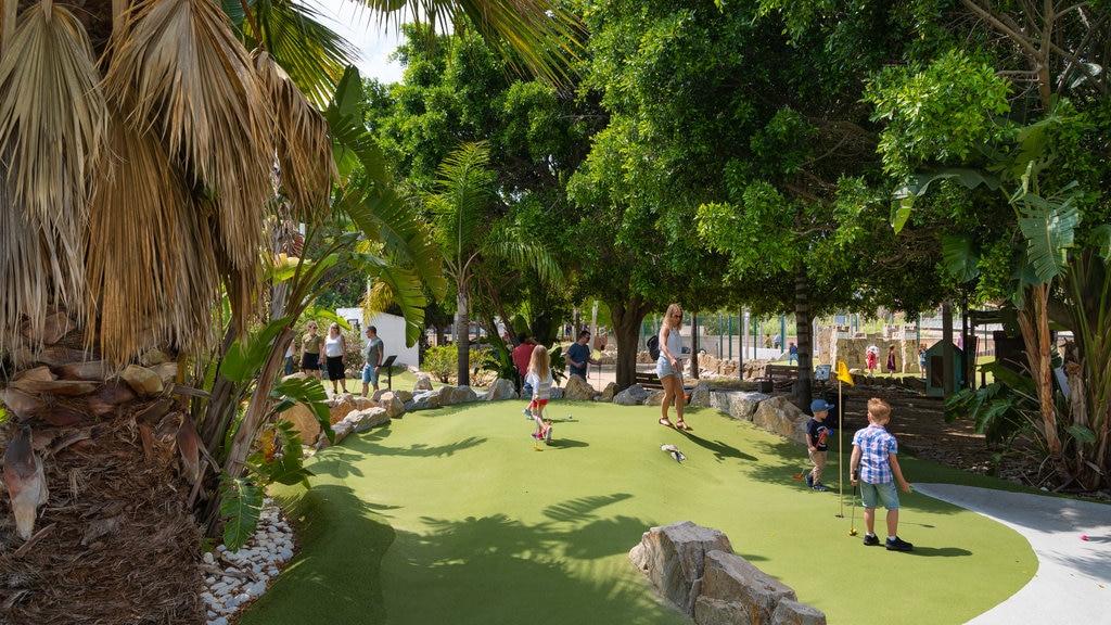 Fuengirola Adventure Golf featuring golf as well as a family