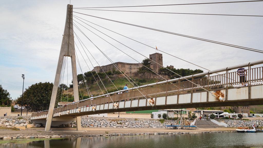 El Castillo Beach which includes a bridge and a river or creek