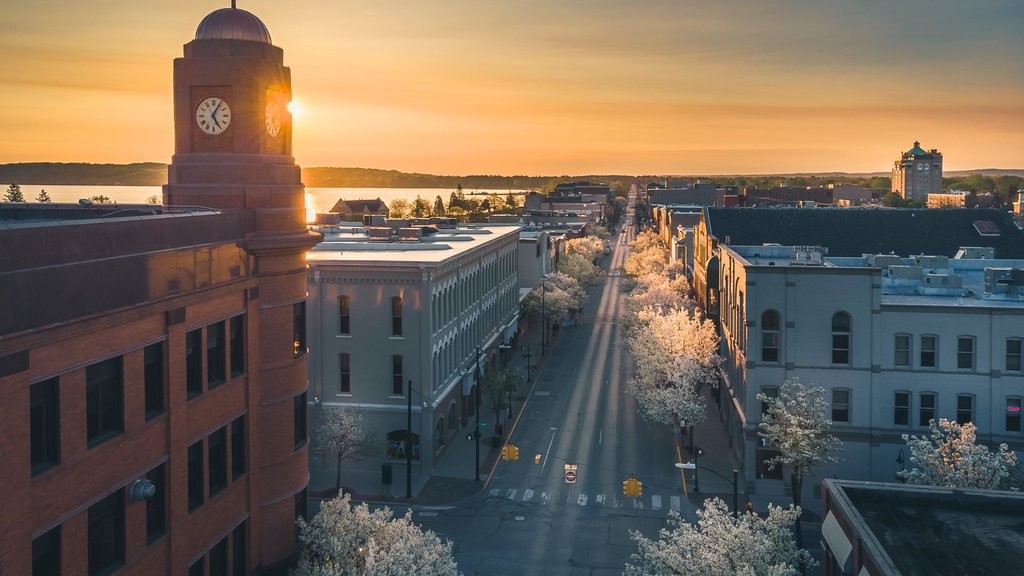 Traverse City which includes a sunset, landscape views and a city