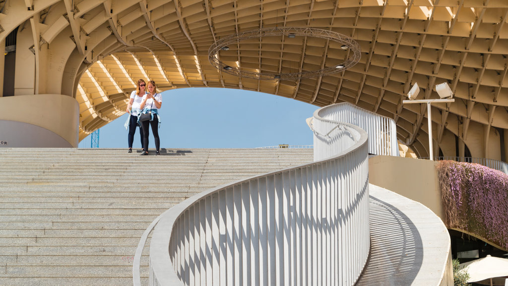 Metropol Parasol showing street scenes and modern architecture as well as a couple