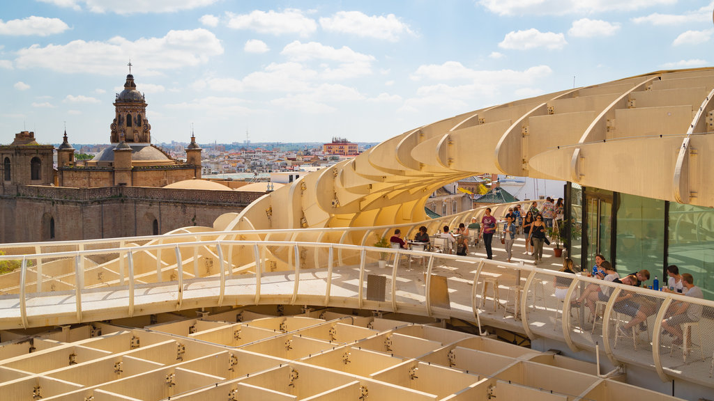 Metropol Parasol which includes modern architecture, a city and landscape views