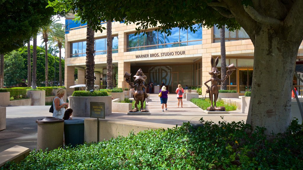 Warner Brothers Studio which includes a statue or sculpture, outdoor art and a garden