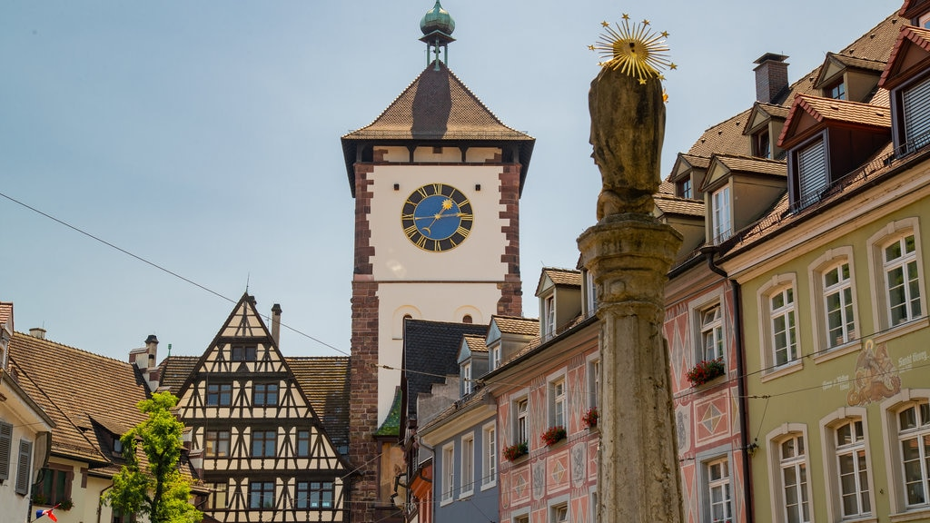 Schwabentor Gate showing a city, heritage elements and outdoor art