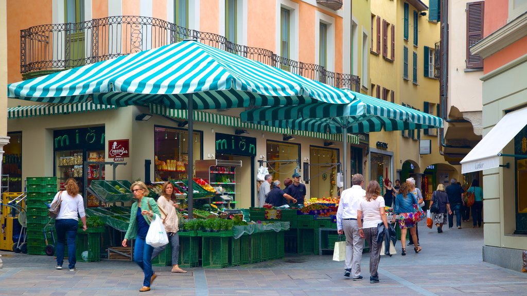Lugano showing street scenes and markets as well as a small group of people