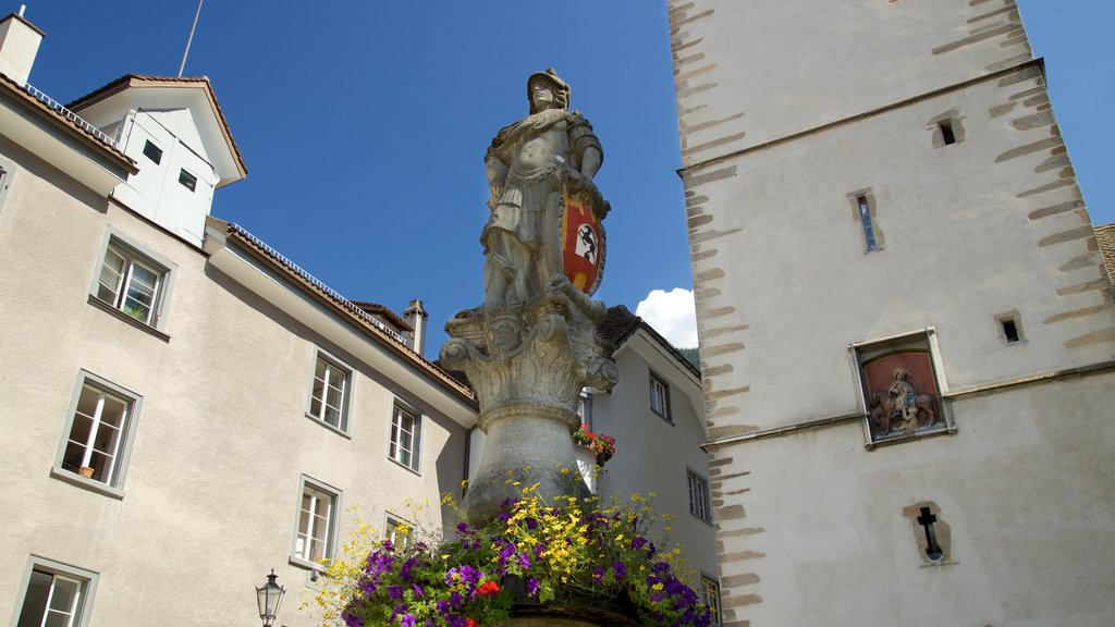 Chur featuring flowers and a statue or sculpture