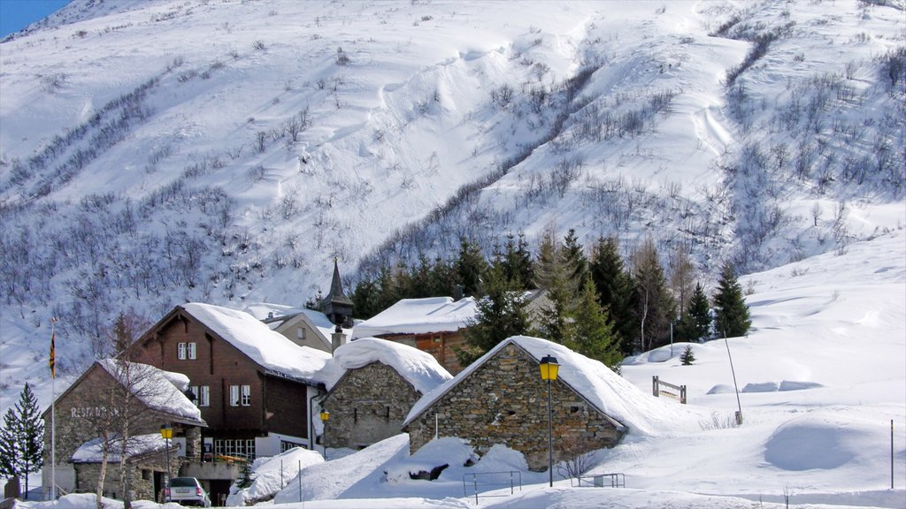 Andermatt featuring snow, a small town or village and mountains