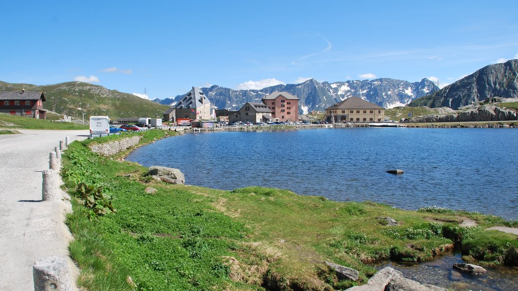 Andermatt showing a lake or waterhole and a small town or village