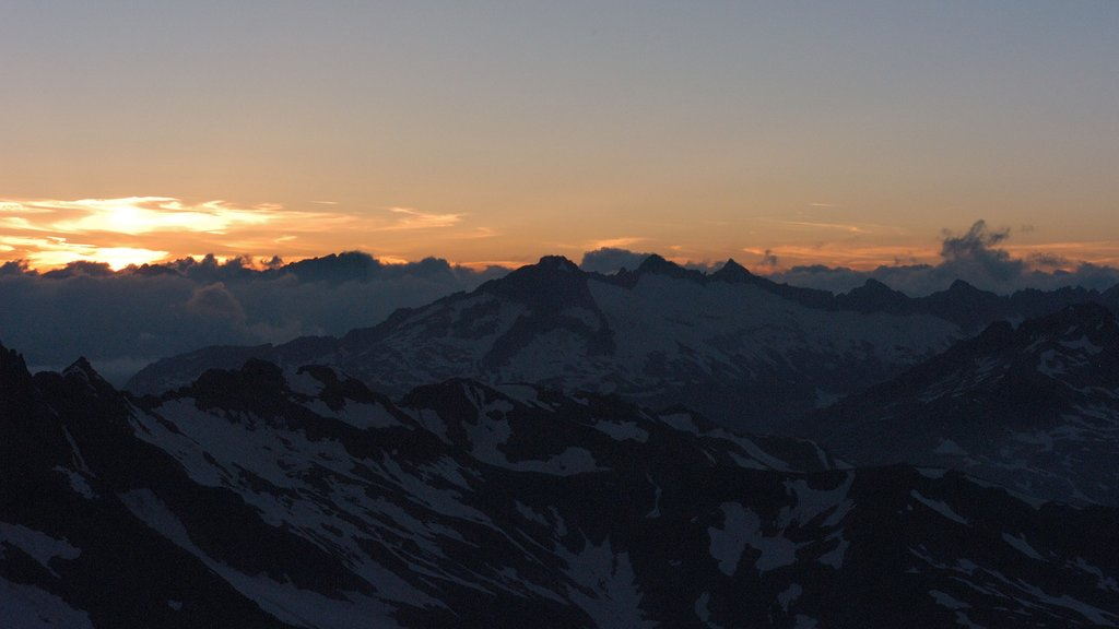 Andermatt featuring a sunset, landscape views and mountains