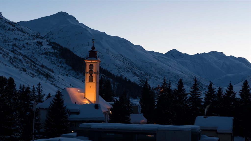 Andermatt which includes night scenes, landscape views and a church or cathedral