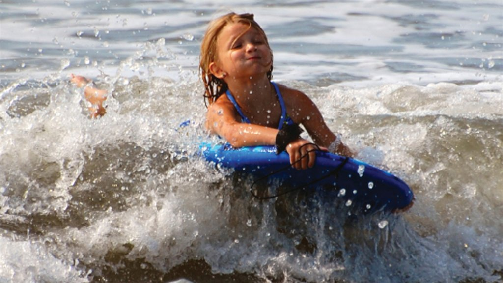 Port Aransas showing surf as well as an individual child