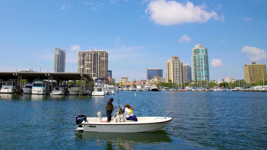 Demens Landing Park showing a skyscraper, central business district and a bay or harbor