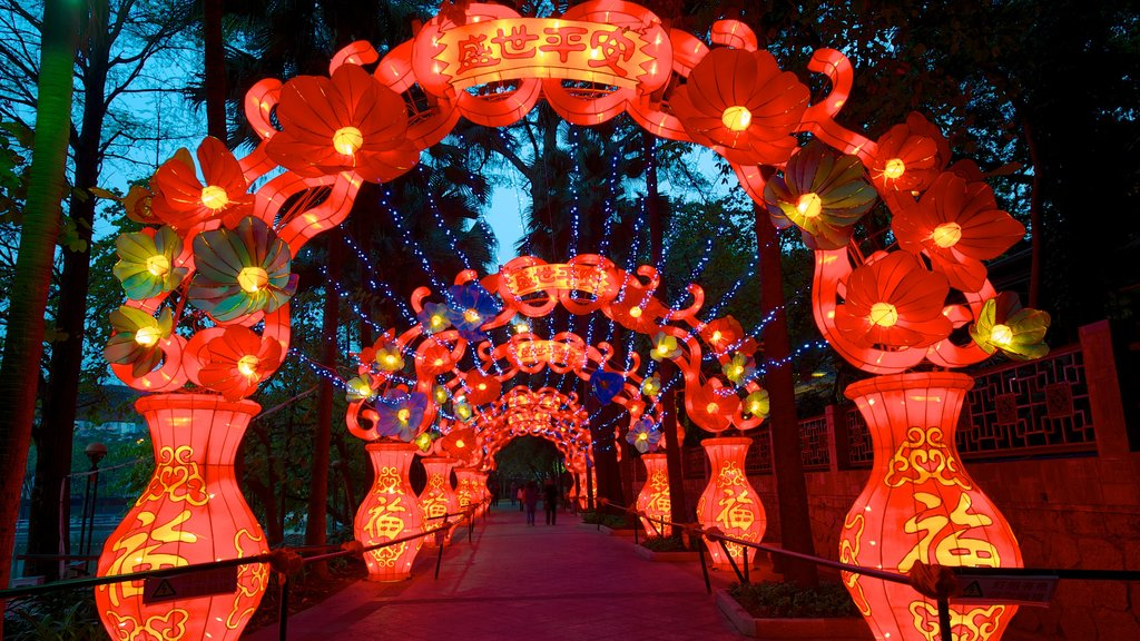Yuexiu Park which includes outdoor art, night scenes and a garden