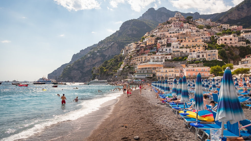 Positano City Centre showing general coastal views, swimming and a sandy beach