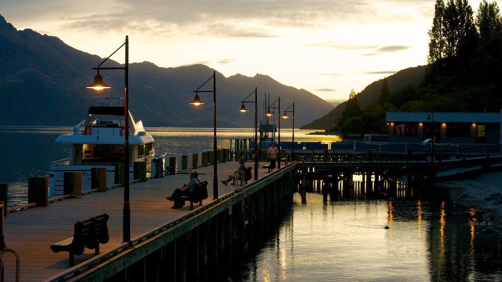 Steamer Wharf showing a marina and a sunset