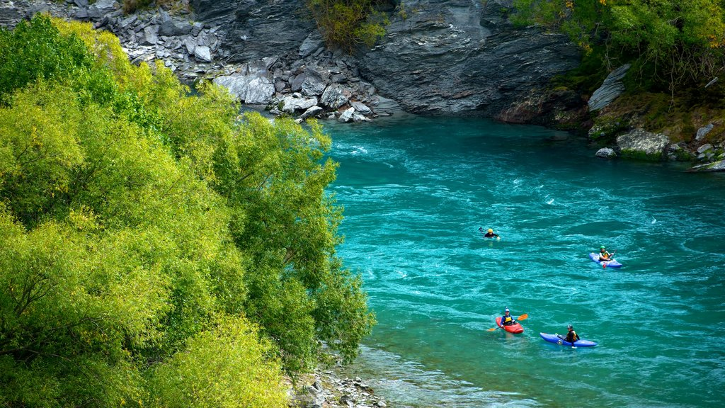 Kawarau Suspension Bridge which includes a river or creek, kayaking or canoeing and rapids