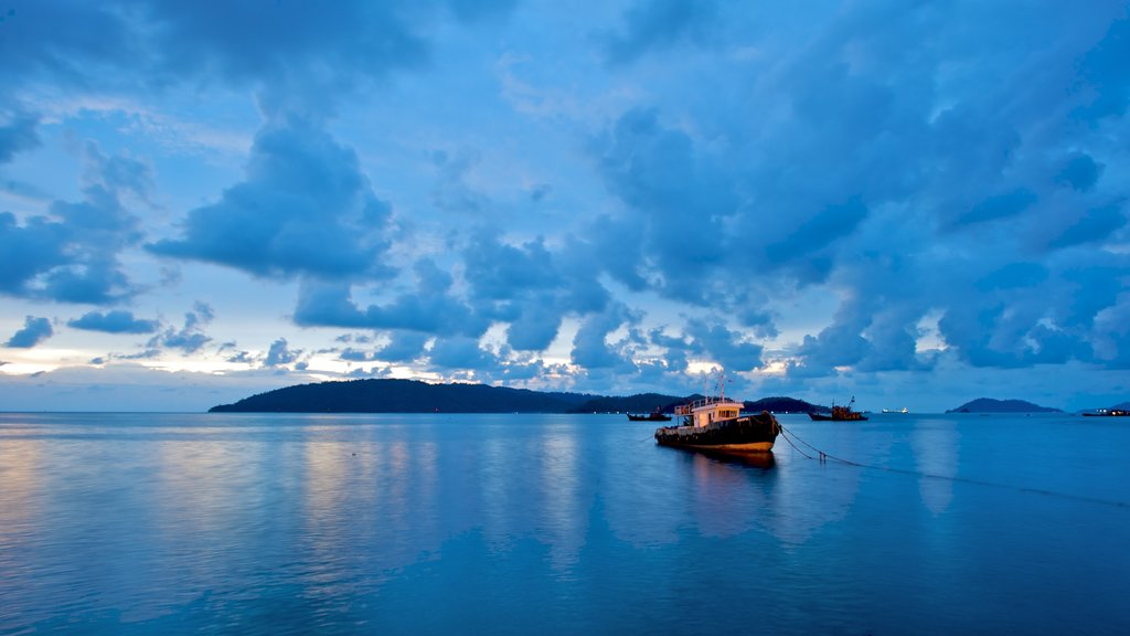 Kota Kinabalu which includes landscape views and boating