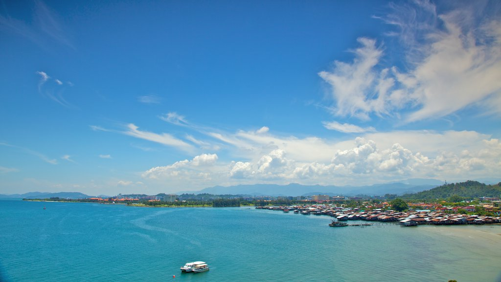 Kota Kinabalu which includes boating, tropical scenes and a coastal town