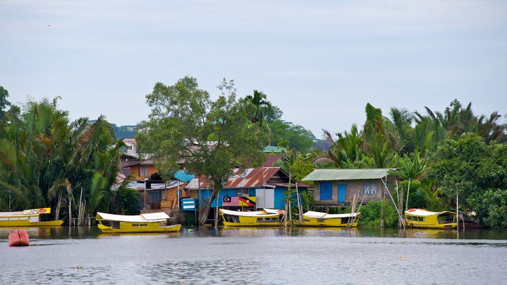 Kuching which includes boating, tropical scenes and a bay or harbor